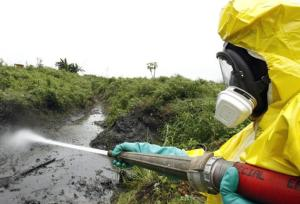 A Dutch worker attempts to clean the waste in Abidjan